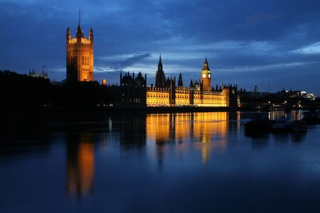 Dusk view of the Houses of Parliament and the River Thames