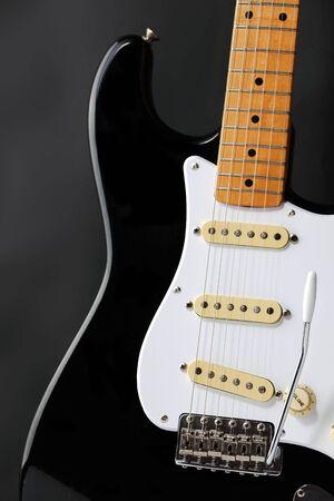 A retro black and white electric guitar body