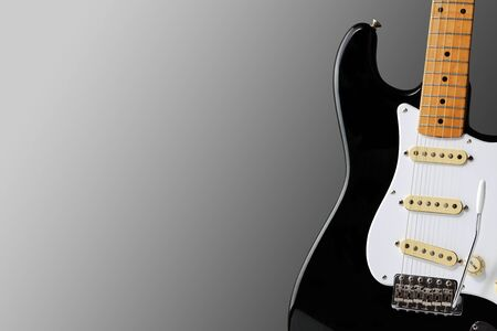 A electric guitar body on graduated background with copy space