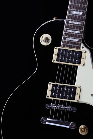 A classic black electric guitar body with white scratchplate