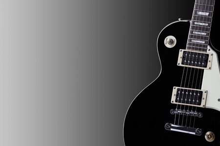 A section of an old black electric guitar body with copy space Stock Photo