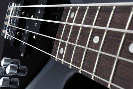 A Bass guitar neck pickups bridge volume pots selective focus