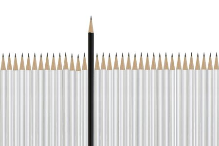 A black pencil among white pencils signifying difference beating the odds success Stock Photo