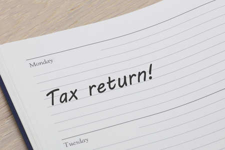 tax return diary reminder open on desk