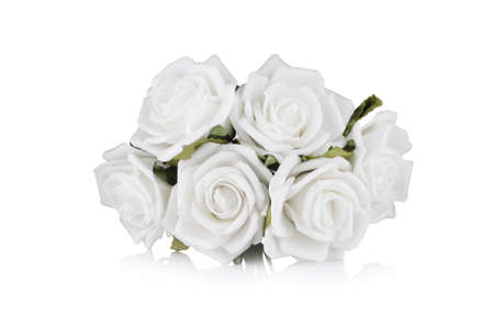 White paper roses on white with reflection