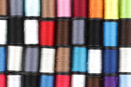 Multi colored reels of cotton background texture image