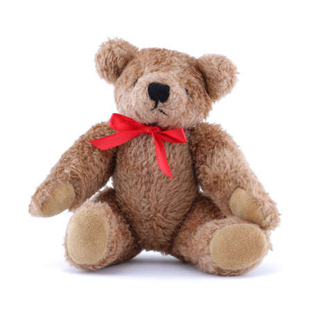 Teddy bear with red ribbon sitting on white