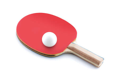 A table tennis ball resting on a table tennis bat paddle on white