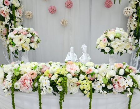 Wedding table with flower arrangements photo