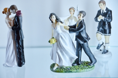 bridegrooms: brides and bridegrooms figures for a wedding cake on the top Stock Photo