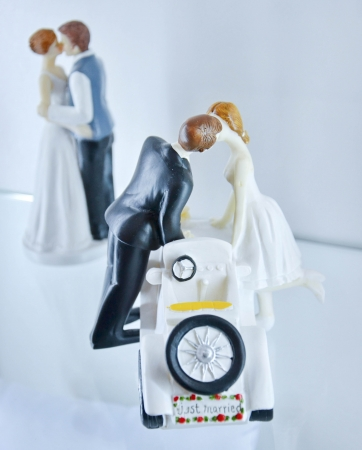 bridegrooms:  brides and bridegrooms figures for a wedding cake on top Stock Photo