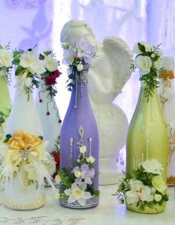Decorated wedding bottles photo