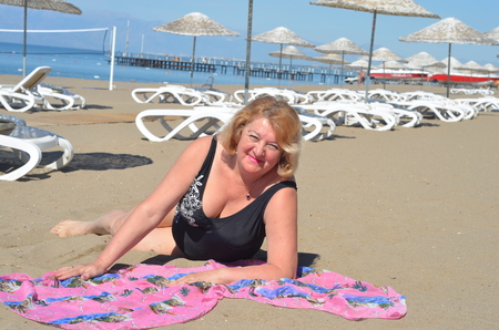 Happy mature woman on the beach