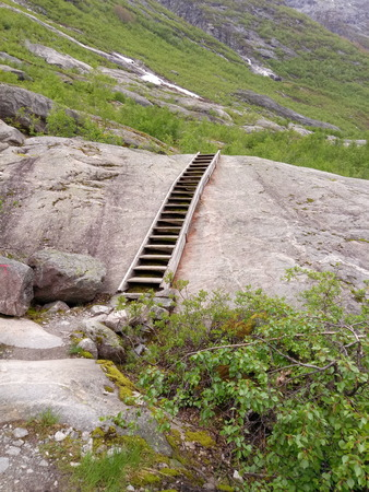 clear path: mountain landscape with wooden stairs