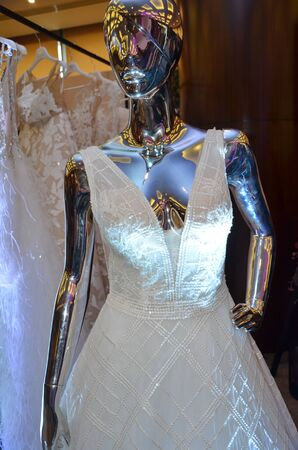 white short sleeved wedding dress  on mannequin