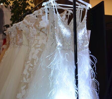Wedding dress hanging on hangers on a rack Stock Photo
