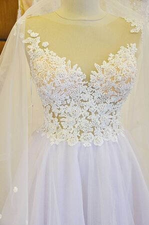 pure white wedding dress in  wedding  shop on mannequin Stock Photo