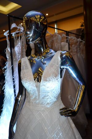 Original wedding  dress with short sleeves on a mannequin. Vertical