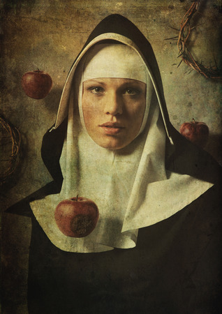 nuns: The temptation to sin nuns.  Apple of temptation to sin. Stock Photo