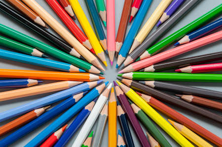 Multi-colored pencils are arranged in a circle in the form of rays