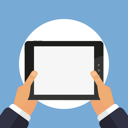 Tablet computer in hand on a blue  background