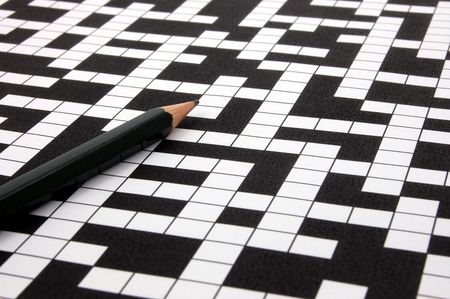 puzzling: a shot of a crossword puzzle and pen                                    Stock Photo