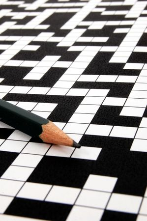 a shot of a crossword puzzle and pen                                    Stock Photo