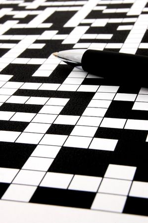 a shot of a crossword puzzle and pen                                    photo