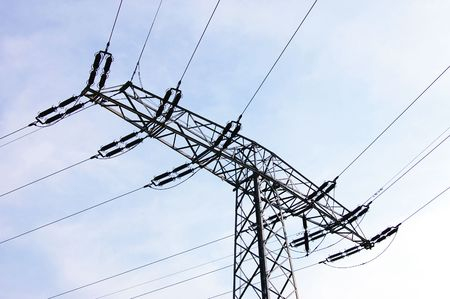 telegraphs: power lines and tower on background of blue sky