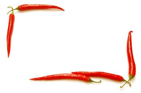 Red chilli peppers frame isolated on white background                      photo