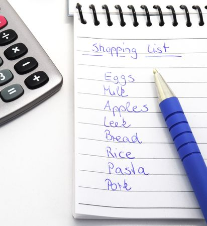 custumer: Shopping List with pen isolated on white background. Stock Photo