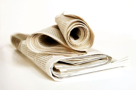pile of old newspaper on a white background Stock Photo - 6698999