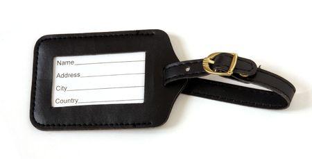 black leather suitcase label isolated on white background Stock Photo - 6920933