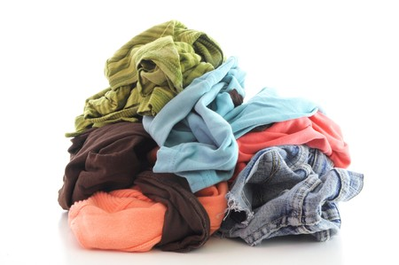 messy clothes: a pile of dirty clothing isolated on white background Stock Photo