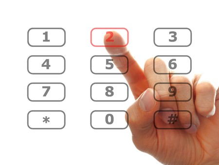keypad: human finger dial a telephone number, isolated on white background  Stock Photo