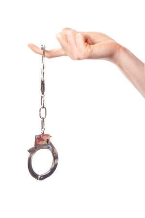 hand wearing handcuffs isolated on white background Stock Photo - 7911508