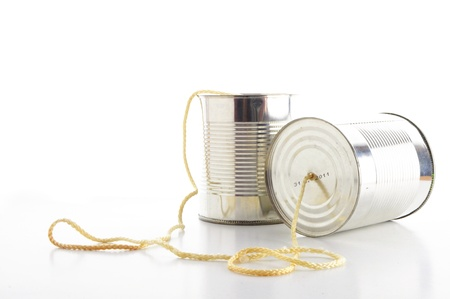 closeup of a tin cans phone isolated on white background, communication concept photo