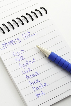 Shopping List with pen isolated on white background. Stock Photo