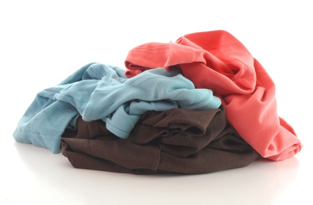 a pile of dirty clothing isolated on white background photo