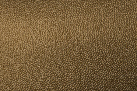 textrured: a natural brown leather texture. close up.