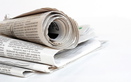 pile of old newspaper on a white background photo