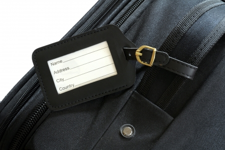 black leather label on a black suitcase  photo