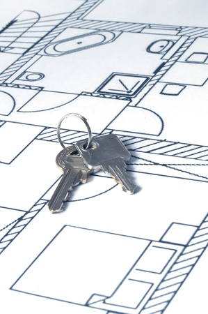 relocate: house key on a blueprint - relocate concept Stock Photo