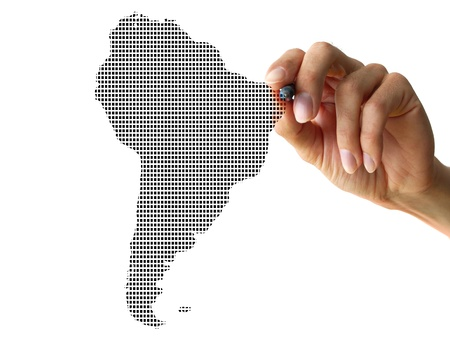 southamerica: a human hand drawing a part from the world Stock Photo