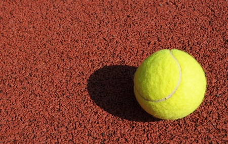 accesory: yellow tennis ball on the tennis court
