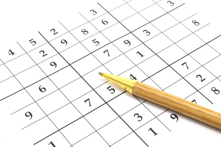 sudoku: closeup of an unfinished sudoku puzzle with brown pen