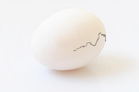 birth white cracked egg isolated on white backgound Stock Photo - 9300028