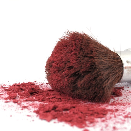makeup brush and cosmetic powder isolated on white background photo