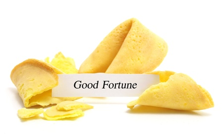 presage: open fortune cookie isolated on a white background