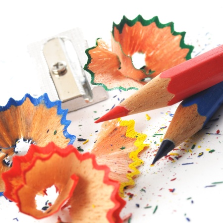 sharpenings: red, blue and green pencil shaving on white background